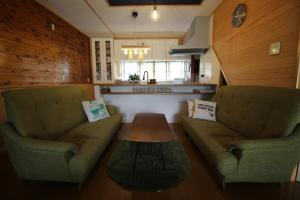 A seating area at 晴家(HALELUYA) Guest House