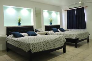 A bed or beds in a room at Esmeralda