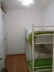 A bunk bed or bunk beds in a room at Apartamento Rio Marinas Nerja 46