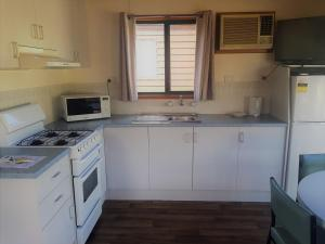 A kitchen or kitchenette at Riverglen Holiday Park