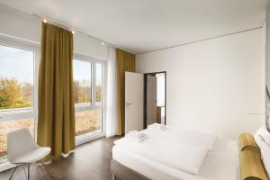A bed or beds in a room at Super 8 by Wyndham Munich City North
