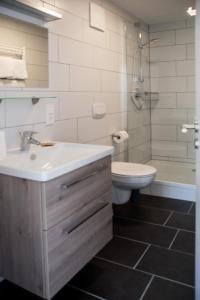 Ein Badezimmer in der Unterkunft Moserhof-Apartments