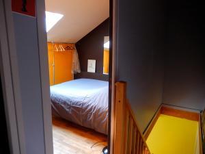 Un ou plusieurs lits dans un hébergement de l'établissement La maisonnette