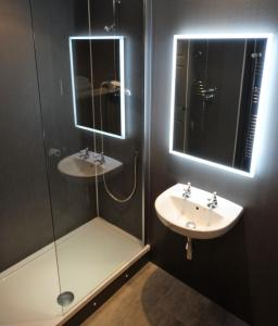 A bathroom at Cantley House Hotel - A Bespoke Hotel