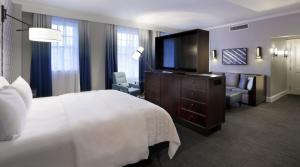 A television and/or entertainment center at Le Meridien Dallas, The Stoneleigh
