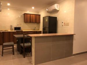 مطبخ أو مطبخ صغير في فيلا للأجنحة الفندقية