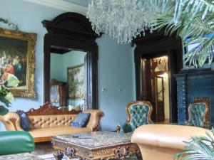 A seating area at Romantic Chateau Krasna Lipa