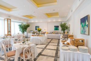 A restaurant or other place to eat at Kydon The Heart City Hotel