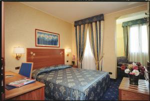 Кровать или кровати в номере Hotel Dieci