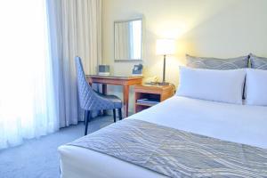 Uma cama ou camas num quarto em Soho Brisbane