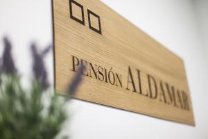 Logo o señal de este hostal o pensión