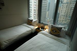 A bed or beds in a room at Hotel MK (newly-renovated)