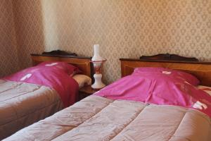 A bed or beds in a room at Flower
