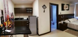 MAIsuitesにあるキッチンまたは簡易キッチン