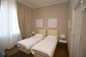 Letto o letti in una camera di Linate Residence