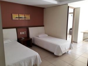 A bed or beds in a room at Hotel Castelo