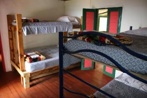 A bunk bed or bunk beds in a room at Ecolife Calima