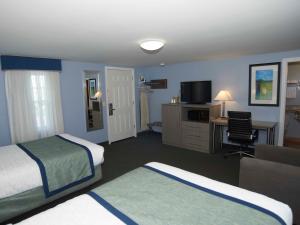 Letto o letti in una camera di Sandwich Lodge & Resort