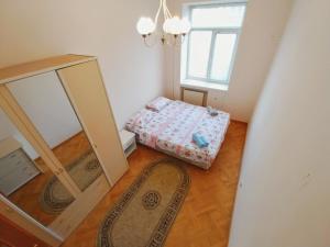 Cama ou camas em um quarto em Clock Tower Apartment in Baku