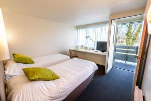 Ein Bett oder Betten in einem Zimmer der Unterkunft Campanile Toulouse Sesquieres