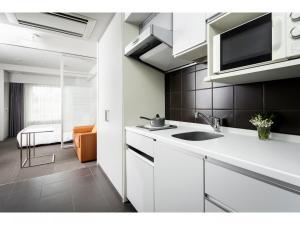 A kitchen or kitchenette at Citadines Shinjuku Tokyo