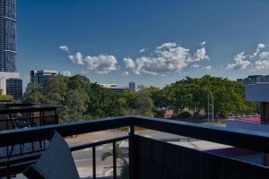 Uma varanda ou terraço em Soho Brisbane