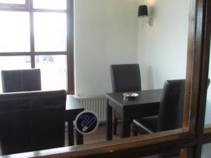 Een TV en/of entertainmentcenter bij Badhotel Zeecroft
