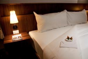 A bed or beds in a room at Flor de Mayo Boutique Hotel, Spa & Restaurant