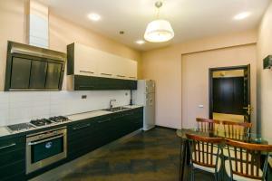 A cozinha ou cozinha compacta de TEATR RASHIDA BEIBYTOVA 2