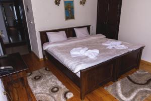 Ένα ή περισσότερα κρεβάτια σε δωμάτιο στο Μπαλκόνι Ζαγορίου