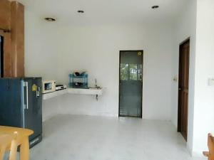 A kitchen or kitchenette at Orange house on the hill Kata
