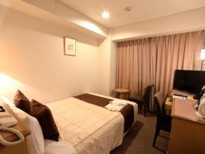 Tempat tidur dalam kamar di Sunwest Hotel Sasebo