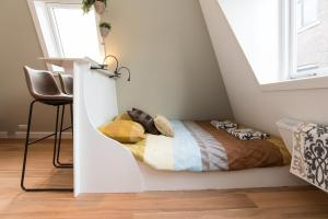 A bed or beds in a room at Saint Claire Studio's