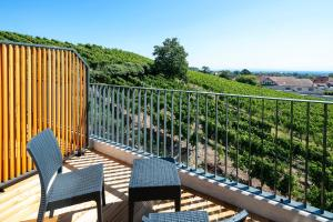 A balcony or terrace at Best Western Hotel & SPA Le Schoenenbourg