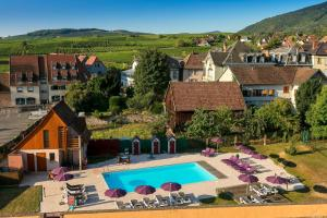 A view of the pool at Best Western Hotel & SPA Le Schoenenbourg or nearby