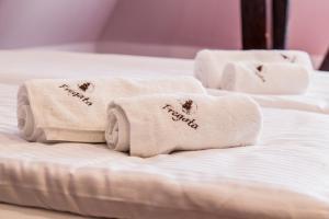 Łóżko lub łóżka w pokoju w obiekcie Fregata