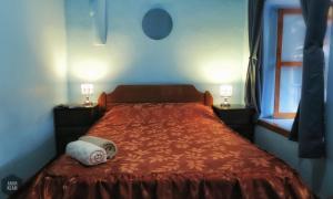 Cama o camas de una habitación en OkiDoki Cusco Hostal