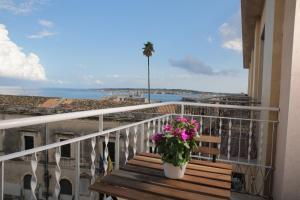 A balcony or terrace at Maison Ortigia