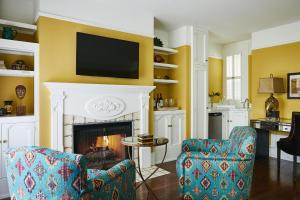 A television and/or entertainment center at Petite Auberge