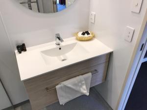 A bathroom at The Village Inn Hotel