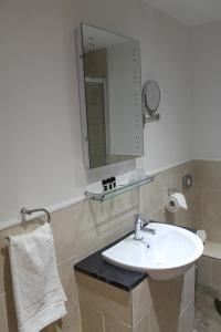 A bathroom at Best Western Brome Grange Hotel