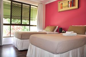 A bed or beds in a room at TL Warmest Homestay