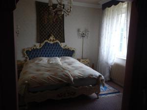 Ein Bett oder Betten in einem Zimmer der Unterkunft Villa Turckheim