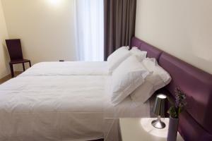 Кровать или кровати в номере Residenza Agnello D'Oro
