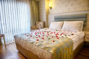 Кровать или кровати в номере Florenta Hotel