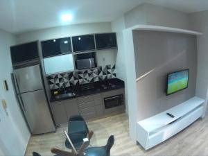 A kitchen or kitchenette at Apto 203B Unique Residence - Alto Padrão