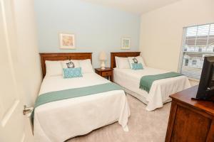 Cama ou camas em um quarto em West Lucaya by FVH