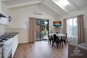 A kitchen or kitchenette at Port Fairy Holiday Park