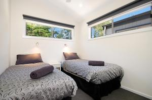 A bed or beds in a room at Port Fairy Holiday Park