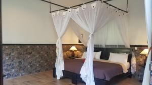 A bed or beds in a room at Doubleyou Home Stay